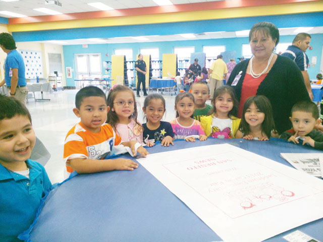Landrum Elementary School pre-kindergarten, kindergarten and first grade students are seen participating in the campus' Career Day festivities on Friday. San Benito News Managing Editor Michael Rodriguez made a presentation at Career Day informing students about the inner workings of modern day journalism as well as the production and distribution of the newspaper. (Staff photos by Michael Rodriguez)