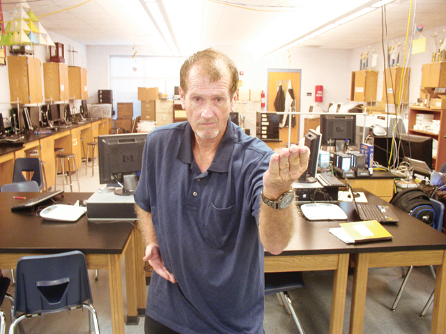 Tom Kuhn, an AP chemistry teacher at San Benito High School, is a national taekwondo championship qualifier. He is shown inside his classroom Tuesday morning. (Staff photo by Michael Rodriguez)