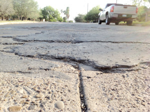 A patch of road on Travis Street in San Benito displays how years of wear and tear have wreaked havoc on many heavily-used streets. (Staff photo by Michael Rodriguez)