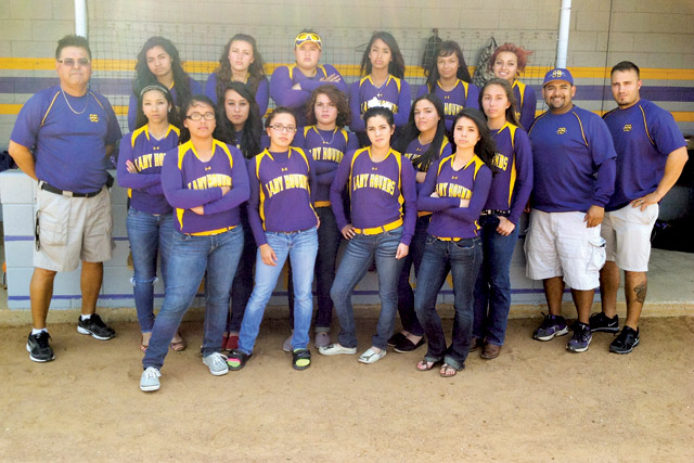 The San Benito Lady Greyhound varsity softball team is shown Monday outside the dugout at the squad's home field. (Staff photo by Francisco E. Jimenez)