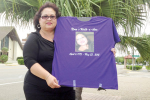 Daisy Ratliff is seen outside the San Benito News office Wednedsay holding a shirt with her daughter, Nora Lisa Saucedo, pictured. (Staff photo by Francisco E. Jimenez)
