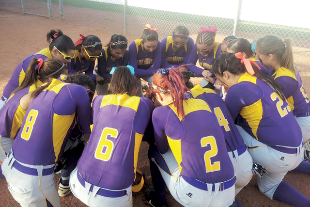 The San Benito Lady 'Hounds are seen praying before their state semifinal game against Lewisville on Friday. It was San Benito's first trip to the state tournament in the school's history. The team was also the first from the Valley to accomplish such a feat. (KSBG TV photo by Isabel Alicia Gomez)