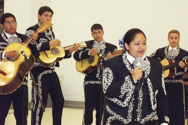 Members of the San Benito Veterans Memorial Academy Mariachi Band along with the San Benito CISD String Orchestra – a group consisting of Miller Jordan, Berta Cabaza and Riverside Middle Schools musicians – are seen performing under the direction of Karina Vela. (Photos by Joe Bocanegra)