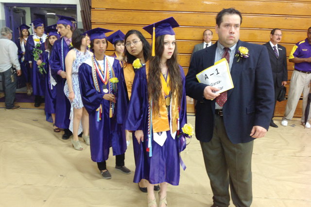 Heavy rain, wind and lightning forced the 2013 San Benito High School Graduation Ceremony indoors Friday evening before yet another change of plans occurred. The event was previously scheduled at Bobby Morrow Stadium, but officials citing safety precautions decided to move the ceremony inside the school's varsity gymnasium. It was then postponed to Saturday at 9:30 a.m. at Bobby Morrow Stadium, this after many graduates and their family members were visibly distraught since only two people per graduate were allowed entry into the gym Friday. (Staff photos by Francisco E. Jimenez)