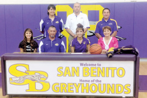 San Benito News photo by Francisco E. Jimenez Seen with San Benito High School faculty and coaches is 2013 graduate Cejay Banuelos (sitting, center). Banuelos, joined by her parents and sister, is shown Thursday signing a letter of intent to attend the Bacone College in Muskogee, Oklahoma, where she plans on playing basketball, inside the SBHS varsity gym.