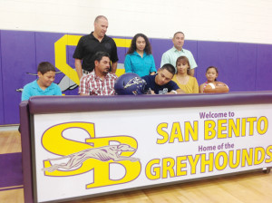 San Benito News photos by Francisco E. Jimenez San Benito High School graduate Jamail Garza is seen Thursday surrounded by family, coaches and faculty inside the SBHS varsity gymnasium, where he signed a letter of intent to attend Graceland University in Iowa.