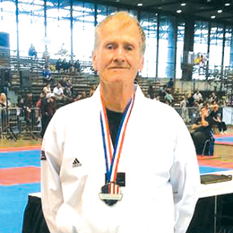 Courtesy photo Thomas Kuhn, a resident of Port Isabel and San Benito High School AP chemistry teacher, is seen with his medal at the USAT (USA Taekwondo) National Championships in Chicago, held July 3-8.