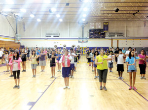 San Benito News photo by Francisco E. Jimenez Members of the San Benito High School Mighty Greyhound Marching Band are seen practicing inside the SBHS gym on Friday as part of a band summit, which lasts Thursday, August 1 to Saturday, August 3.