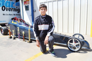 San Benito News photo by Francisco E. Jimenez Leroy Thomae, 13, of San Benito is seen with numerous awards won at recent drag racing competitions.