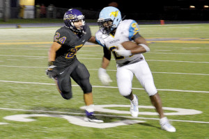 San Benito News photo by Francisco E. Jimenez San Benito Greyhound  defensive back Nathan Mireles chasing down McAllen Memorial rusher Trevor Speights in second half action of Friday's game at Bobby Morrow Stadium.