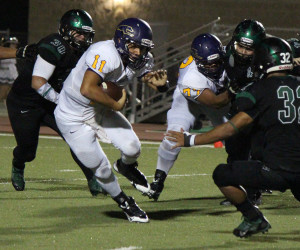 Photo by Balde Olivarez, KSBG-TV/SBCISD San Benito Greyhound quarterback Dylan Castillo is seen looking for running room Friday night against the PSJA Memorial Wolverines in Pharr.