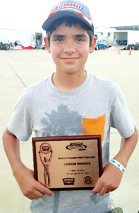 Courtesy photo Leroy Thomae, 13, of San Benito is seen with the plaque he earned Friday, Sept. 27, after winning the International Hot Rod Association junior division crown at the Dallas Raceway in Crandall, Texas.