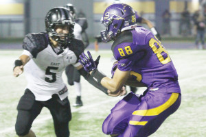 Photo by T.J. Tijerina San Benito Greyhounds wide receiver Manuel Sanchez is seen bracing for a tackle against a Weslaco East defender during Friday night's game at home.
