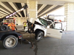 Photo by Jacob Lopez Pictured is the scene of an accident Saturday, Oct. 12, in which a white utility truck crashed between two concrete pillars under the Sam Houston Boulevard and Frontage Road (U.S. Expressway 77/83) overpass.