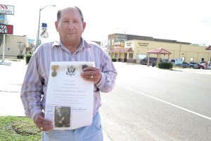 San Benito News photo by Michael Rodriguez Marcelo Casas of San Benito is seen outside the San Benito News office on Friday holding a picture of his uncle, U.S. Navy Pvt. Marcelo Rendon Casas who was killed in WWII at the age of 17.