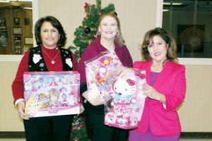 San Benito News photo by Francisco E. Jimenez Toni Crane, Evelon Dale and Shirley Vega are seen inside the San Benito News office on Wednesday with Christmas gifts they plan to donate to needy children in the area.
