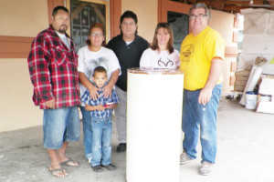 San Benito News photo by Francisco E. Jimenez Seen with their new water heater are, from left to right, homeowners Pete Fonseca and Francis Fonseca with their son Victor Manuel Fonseca, 5, San Benito Communities in Schools Site Coordinator Milton Herrera, and Natasha Taylor and Rod Schmacker of the Los Fresnos Church of Christ.