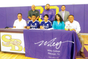 (Photo by Pete Banda) San Benito High School seniors Fernando Sanchez and Adrian Estrada are shown with their families and soccer coaches on Tuesday as they sign letters of intent to play for Wiley College.