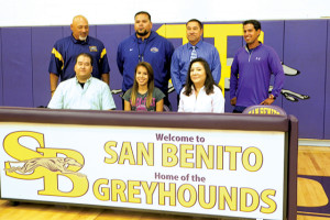 (Photo by Pete Banda) Kristen Marie Rodriguez, a senior track standout at San Benito High school, is seen with her family and coaches as she signs a letter of intent to play for Garden City College.