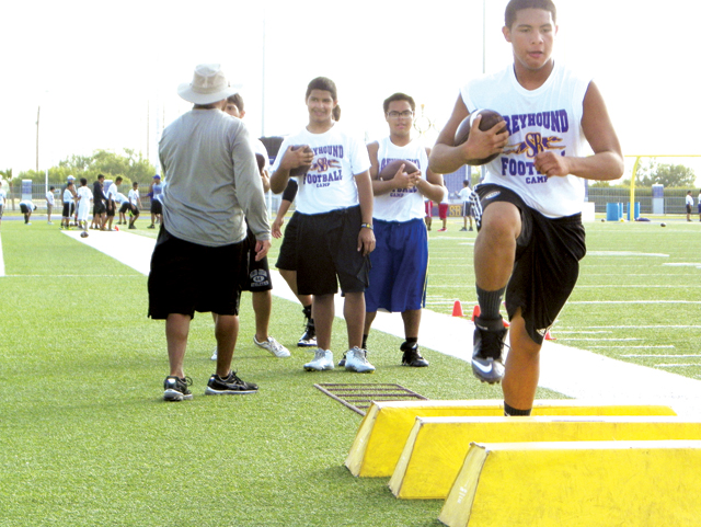 (Staff photo by Heather Cathleen Cox) More than 100 youths attended the Greyhound Football Camp this past week, in which underclassmen were instructed by varsity coaches at Bobby Morrow Stadium.