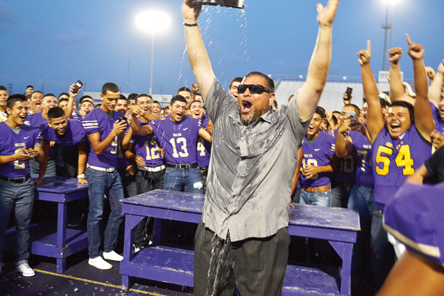 """(Photos by Francisco E. Jimenez) Below: Members of the San Benito CISD Board of Trustees are seen participating in the ALS """"Ice Bucket Challenge"""" during the Meet the Greyhounds community pep rally on Thursday, Aug. 21. Above: Head coach Dan Gomez also participated in the challenge, much to the delight of his teammates and the fans in attendance."""