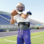 (Photo by Mathew Zuniga) Starting quarterback Christian Sierra warms up during afternoon practice for the San Benito Greyhounds on Tuesday.