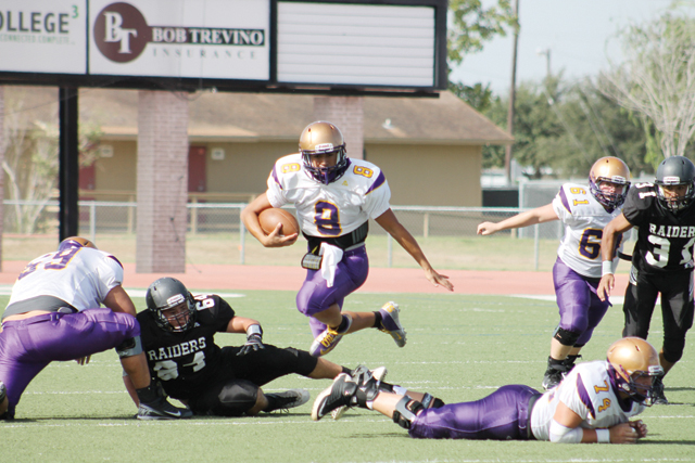 (Photo by Edward Cruz) San Benito Greyhounds quarterback Cristian Sierra leaps over a PSJA North defender during the team's sole scrimmage held at PSJA Stadium on Friday morning.