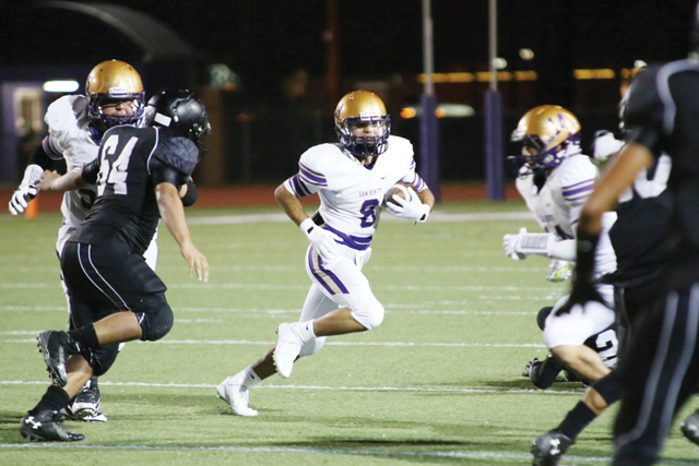 (Photo by T.J. Tijerina) Shown speeding through the Weslaco East defense at Bobby Morrow Stadium on Friday is San Benito's J.R. Gaitan, who has proven himself as one of many offensive weapons for the Greyhounds.