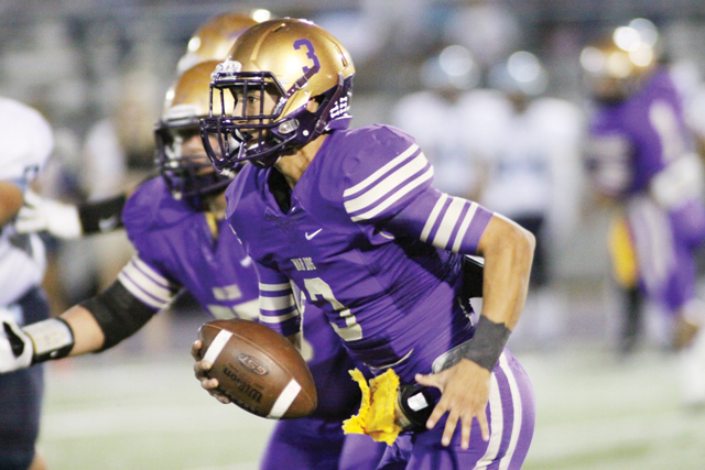 (Photo by T.J. Tijerina) Quarterback Cristian Sierra of the San Benito Greyhounds looks for room to maneuver at Bobby Morrow Stadium on Friday, Sept. 12, against the McAllen Memorial Mustangs.