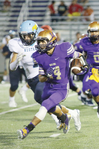 (Photo by Jessica Tijerina) Gabriel Vasquez (above) was one of the bright spots in the San Benito Greyhounds' 42-28 defeat to McAllen Memorial at Bobby Morrow Stadium on Friday. The 'Hounds running back was at it again scoring on both offense and special teams for the purple and gold. For a photo gallery of the game, visit sbnewspaper.com.