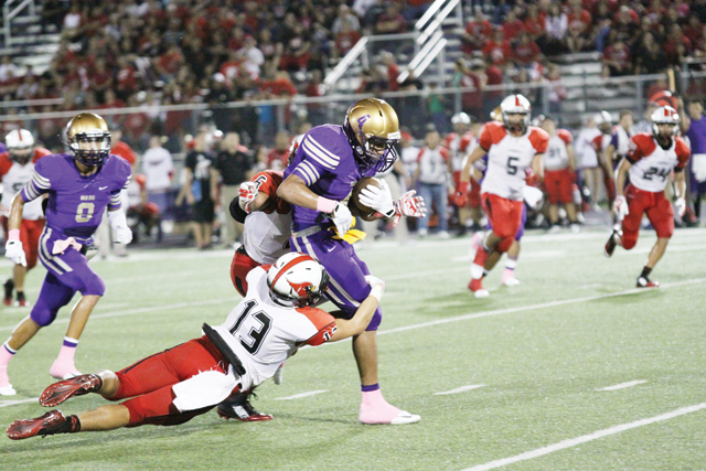 (Photos by T.J. Tijerina and Karen Tijerina) San Benito Greyhounds quarterback Cristian Sierra (No. 3) and wide receiver Armando Medrano (No. 4) are seen during Friday night's epic Battle of the Arroyo matchup against rival Harlingen.