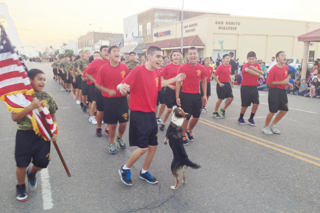 (Staff photo by Jacob Lopez) Kong the dog is seen running along with his friends from the Miller Jordan Middle School LOTC during the Oct. 23 San Benito High School Homecoming Parade.