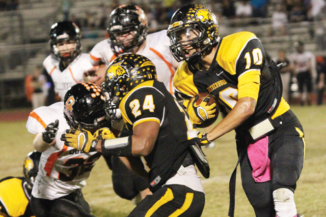 (Photo by T.J. Tijerina) Senior wide receiver Marcos Carrizalez of the Rio Hondo Bobcats is seen running behind a block against the Orange Grove Bulldogs at Bobcat Stadium on Friday, Oct. 24.