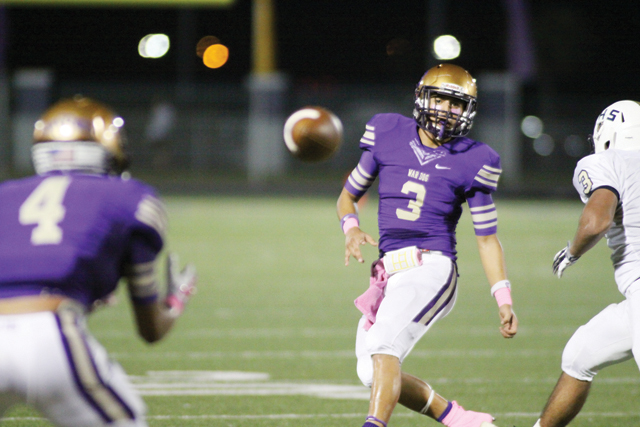 (Photo by T.J. Tijerina) San Benito Greyhounds quarterback Cristian Sierra (No. 3) is seen moments after passing short to wide receiver Armando Medrano (No. 4) in Friday's game against Brownsville Lopez at Bobby Morrow Stadium.