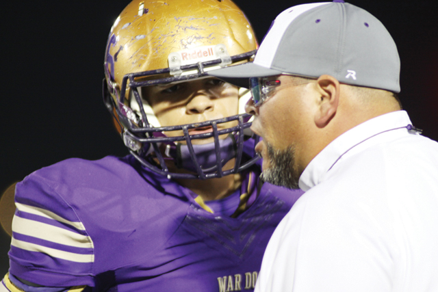 (Photo by T.J. Tijerina) San Benito Greyhounds Head Coach Dan Gomez gives instructions during Friday night's game against Brownsville Lopez at Bobby Morrow Stadium.