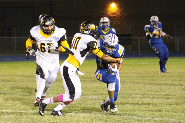 (Photo by Marina Wise-Herring) Making a tackle Marcos Carrizalez of the Rio Hondo Bobcats makes a tackle against a Raymondville Bearkats ballcarrier on Friday in Raymondville.