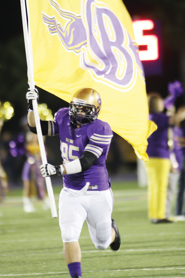 Good times San Benito Greyhounds defensive lineman John Alvarez, a sophomore, is seen leading the team onto the field during October's Homecoming game at Bobby Morrow Stadium. (Photo by T.J. Tijerina)