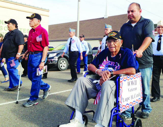 World War II veteran Lupe H. Conde (wheelchair) is seen participating in San Benito's annual Veterans Day march down Sam Houston Boulevard on Tuesday, Nov. 11.