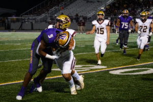 'Hounds runover Falcons in district opener